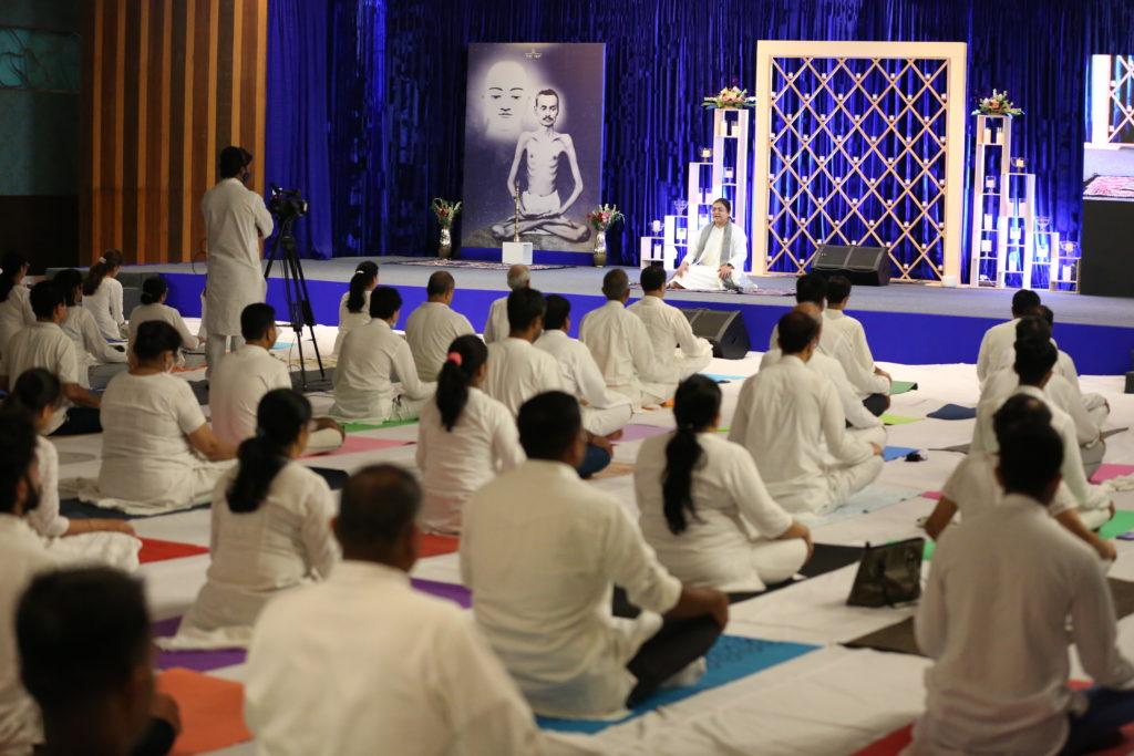Seekers learning YogaYog at Guru Poornima 2021 celebrations from Sri Guru.