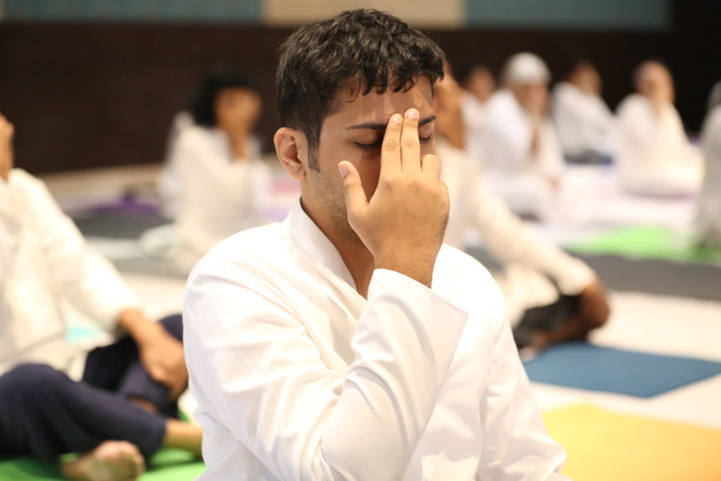 A seeker performing Yoga at Guru Poornima 2021 celebrations.